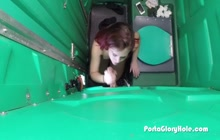 Redhead sucking cocks on gloryhole