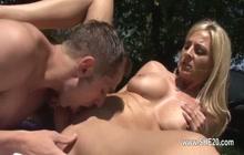 Big boobed MILF sucking cock outdoors
