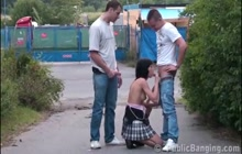 Czech slut handles 2 cocks in public